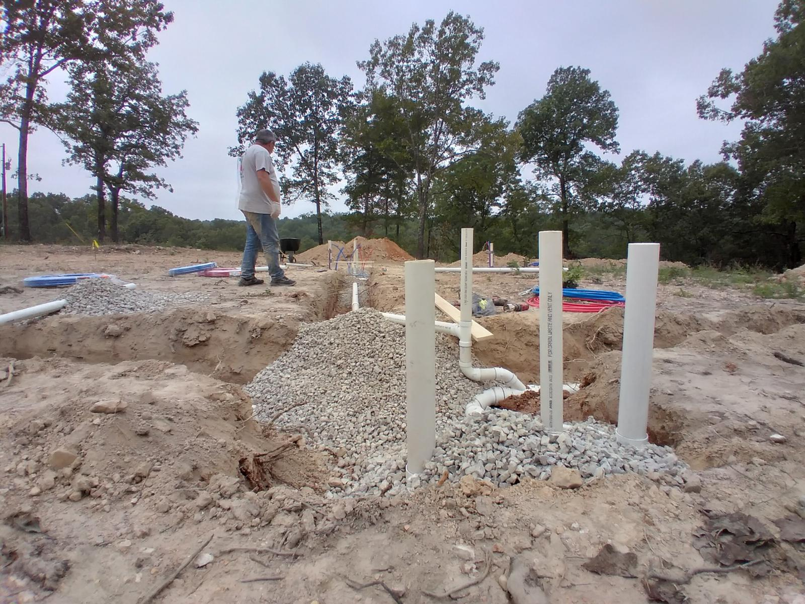 Laying pipe in the ground before a cement pad is poured for a new home.