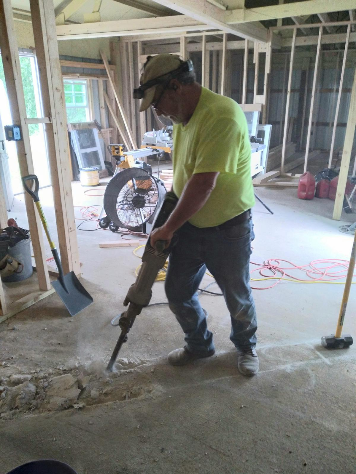 And the only way to get drain pipes under a pre-existing cement pad, Jack hammers!