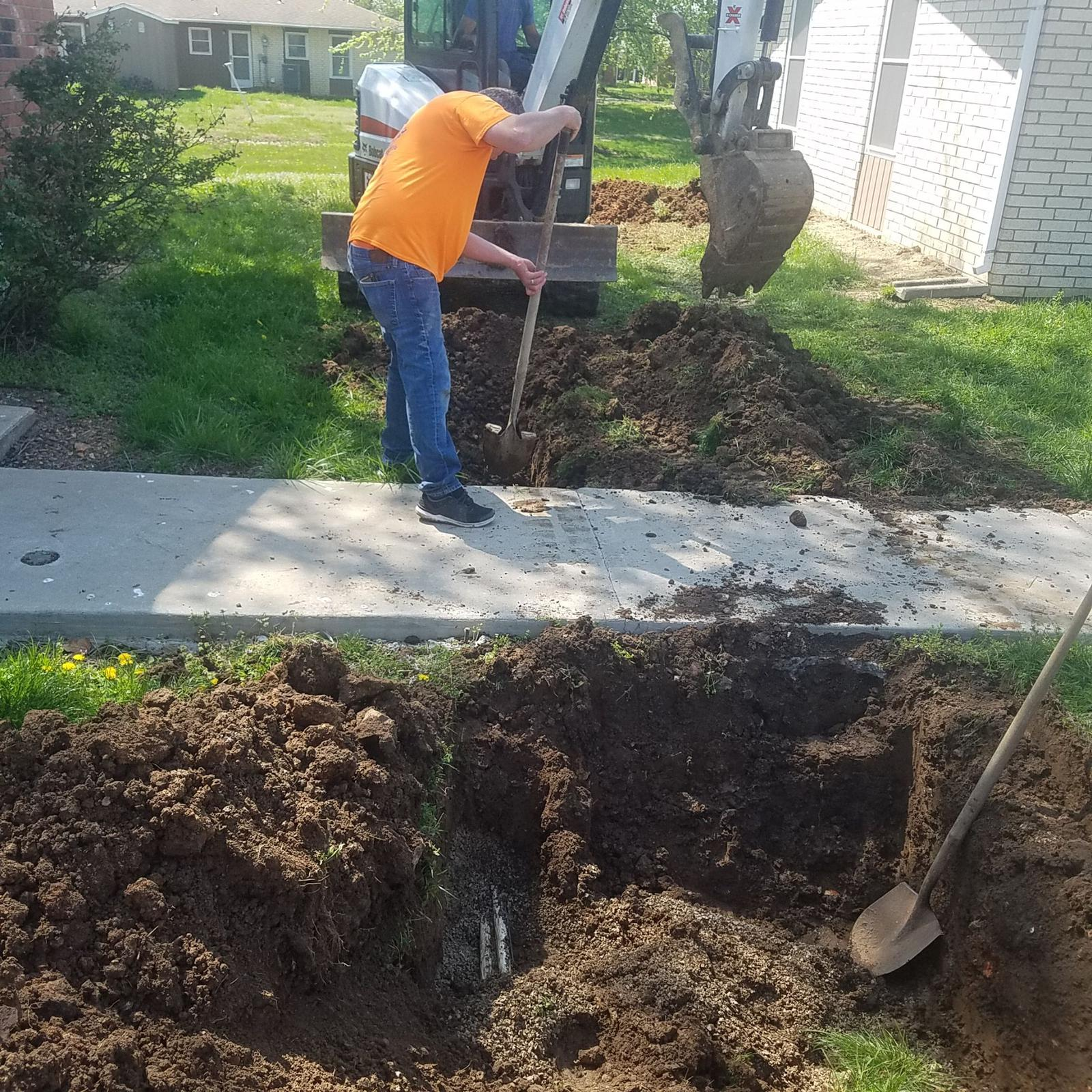 Actually, fixing a leak is the EASY part of plumbing. Finding the leak and getting to it is the hardest part. This pipe happened to burst under a sidewalk. This is randy doing his impression of a backhoe, lol.