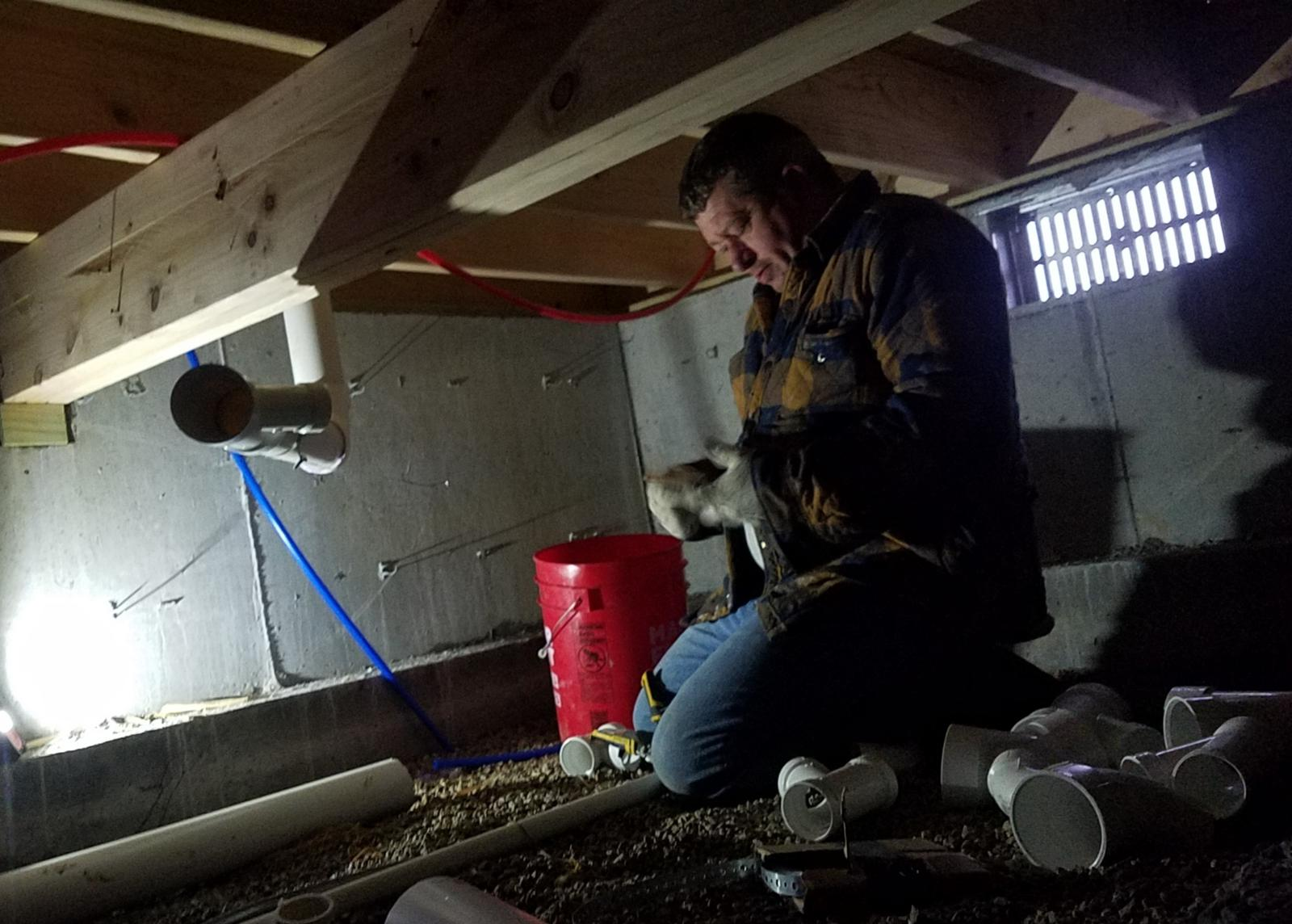 This is Randy building new drain lines (roughing-in)under a new house. He truly is a master of his craft!